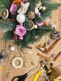 Christmas flower composition. Christmas gifts decoration and making. Festive gift Cardboard boxes, ribbon, fir brunches, cissors. Christmas handmade diy royalty free stock photos