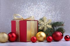 Christmas gifts. Christmas decoration with presents and red ball with fir branches royalty free stock photo