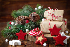 Christmas gifts. And decoration on wooden background Stock Photos