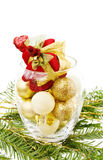 Christmas gifts decorations. Love Christmas celebration with traditional pine tree branch and a bowl with golden baubles and gift decoration. Isolated on white stock photos