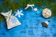 Christmas gifts and decorations on fir branches on a blue background Stock Photography