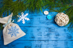 Christmas gifts and decorations on fir branches on blue background Royalty Free Stock Photography
