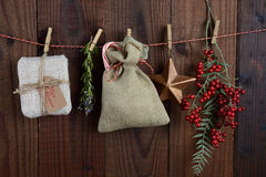 Christmas Gifts and Decorations Hanging From Twine Stock Image