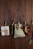 Christmas Gifts and Decorations Hanging From Twine Stock Photos