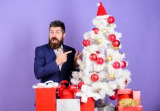 Christmas gifts and decorations. How to organize awesome office christmas party. Preparation and celebration. Man. Bearded hipster wear formal suit near royalty free stock images