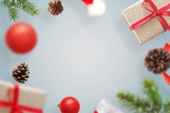 Christmas gifts and decorations levitate above the table. Fre space for text in the middle royalty free stock photos