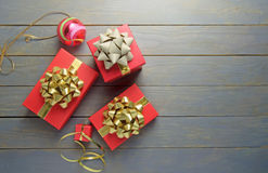 Christmas gifts. And decorations over a wooden background with space Royalty Free Stock Photo