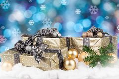 Christmas gifts. And Christmas decorations in the snow stock photos