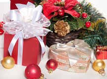 Christmas gifts and decorations on a white Stock Images