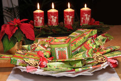 Christmas gifts and decorative candles Royalty Free Stock Photo