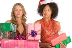 Christmas gifts discrimination between to women Stock Images