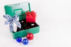 Christmas gifts on an empty cash box Royalty Free Stock Images
