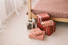 Christmas gifts on the eve of the new year. Christmas presents New Year`s Eve lying on the floor Royalty Free Stock Images