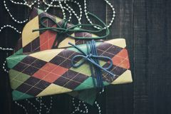 Christmas gifts. Festive boxes in colorful paper on a wooden background in vintage color Stock Photo