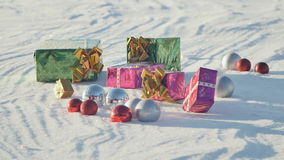 Christmas gifts in a field on snow in a sunny, frosty and clear weather outdoors. stock video footage