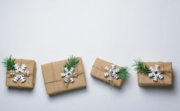 Christmas Gifts with Fir Branches on White Background, Winter Holidays Concept royalty free stock photo
