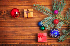 Christmas gifts, fir-tree branch and christmas toys Royalty Free Stock Photos
