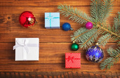 Christmas gifts, fir-tree branch and christmas toys Stock Image