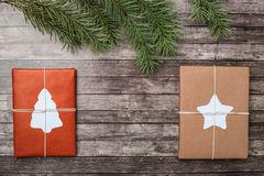 Christmas gifts with fir-tree on wooden background. royalty free stock images