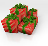 Christmas gifts. Four boxes of Christmas gifts, wrapped with ribbons and bows in beautiful textured papers. Several boxes Stock Image