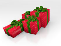 Christmas gifts. Four boxes of Christmas gifts, wrapped with ribbons and bows in beautiful textured papers. Several boxes Stock Photography