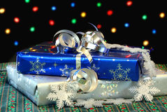 Christmas Gifts in front of Lights Royalty Free Stock Photo