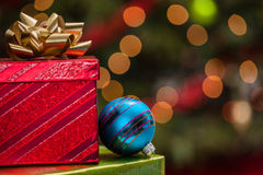 Christmas gifts in front of the tree Royalty Free Stock Photography