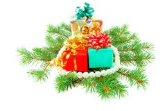 Christmas gifts on fur-tree branches Royalty Free Stock Images