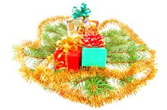 Christmas gifts on fur-tree branches Royalty Free Stock Photo