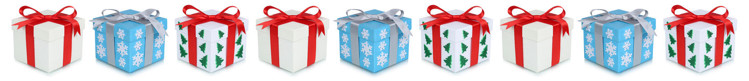 Christmas gifts gift box present in a row isolated Stock Photography