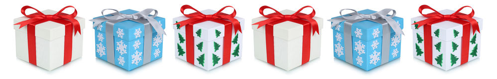 Christmas gifts gift box present in a row isolated on white Royalty Free Stock Photos