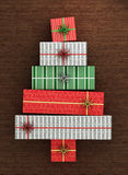 Christmas gifts. Gift boxes arranged as christmas tree on wooden floor. 3d rendered illustration stock illustration