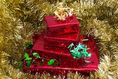 Christmas gifts on gold Royalty Free Stock Photos