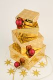 Christmas gifts, gold with red Stock Images
