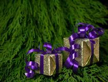 Christmas gifts on green background. Two golden christmas boxes on green background (copy space Stock Photos