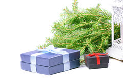 Christmas gifts, green spruce and lantern Royalty Free Stock Images