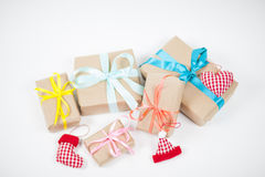 Christmas Gifts. Handmade multicoloured gifts and decorations on white background Stock Images
