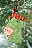 Christmas gifts, Happy New Year, embroidery. Decoration on Christmas Tree, Gift Packaging, colorful sock hanging on a branch with snow in the coniferous forest Royalty Free Stock Photography