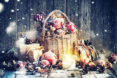 Christmas Gifts In Basket And Burning Candle. Vintage Style Stock Image