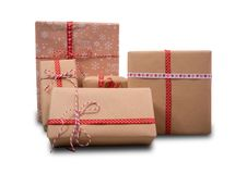 Christmas gifts isolated with red and white ribbons Royalty Free Stock Image