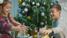 Christmas gifts kids throw at each other stock footage