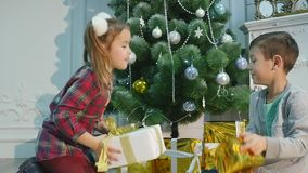 Christmas gifts kids throw at each other stock video