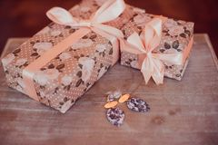 Christmas gifts in a Kraft package on the background of a garland. New year concept royalty free stock photos
