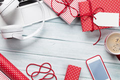 Christmas gifts, laptop, headphones and coffee Royalty Free Stock Images