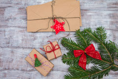 Christmas gifts and letters on a wooden background Stock Image