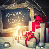 Christmas gifts with lighted candles Royalty Free Stock Images