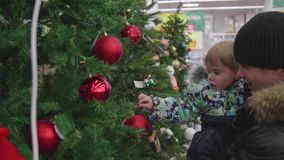 Sale of toys and Christmas trees until xmas. People in the supermarket are shopping before the new year. Christmas gifts. Christmas gifts for loved ones stock footage