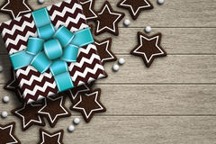 Christmas gifts lying on wooden desk Stock Images