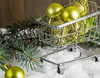 Christmas gifts in a mini shopping cart. Celebratory presents in a shopping trolley stock image