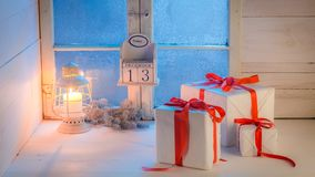 Christmas gifts moving on white table by blue frozen window stock video footage